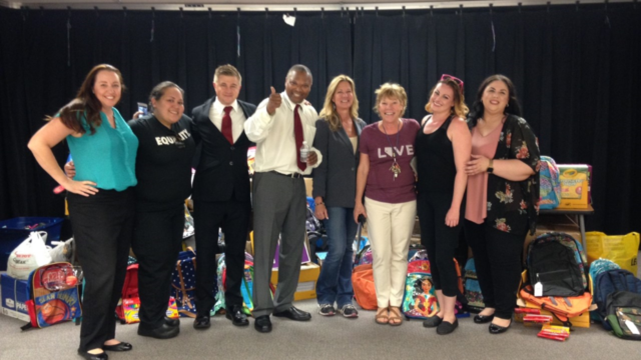 Red Rock employees donate school supplies