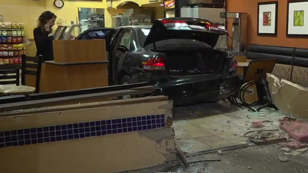 Woman crashes into Subway, fights worker inside