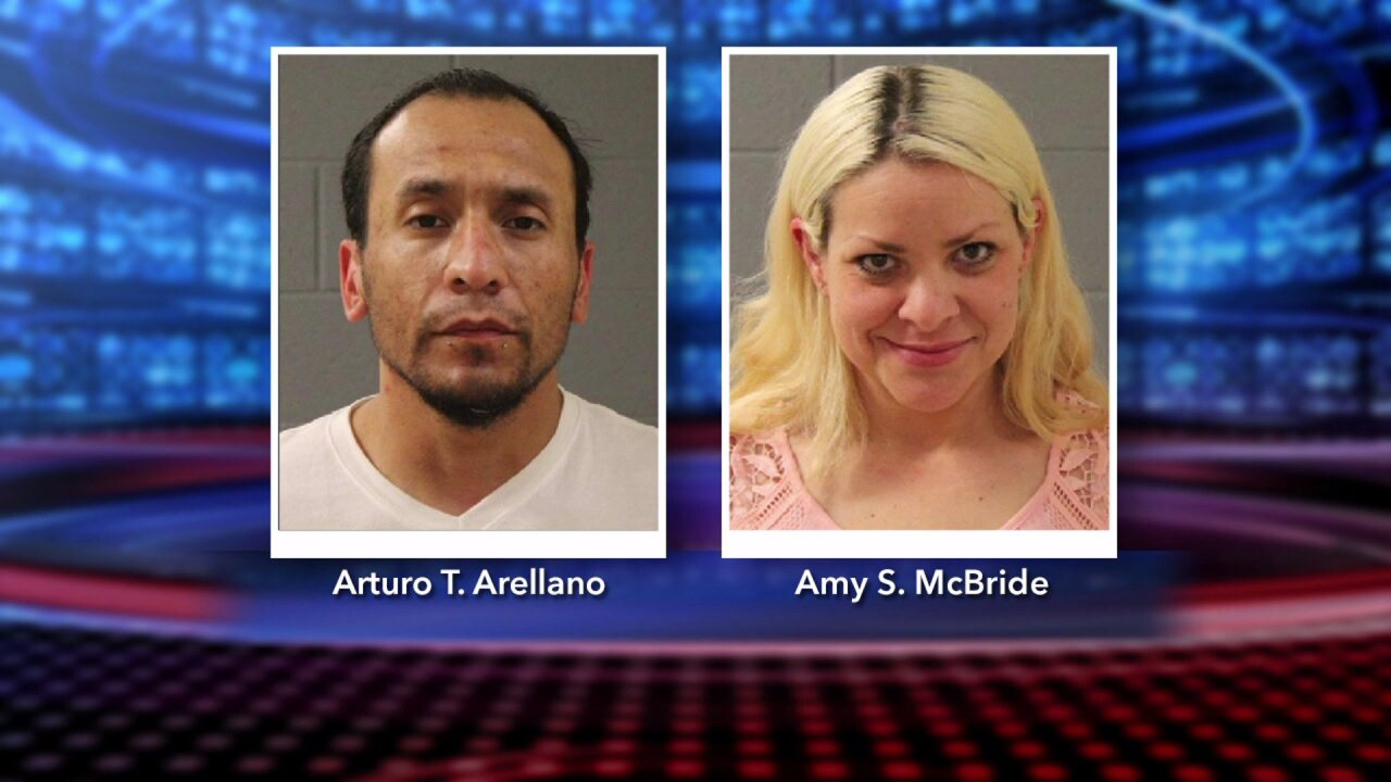 Pair arrested in St. George with over 50 stolen credit cards on the floor of their car