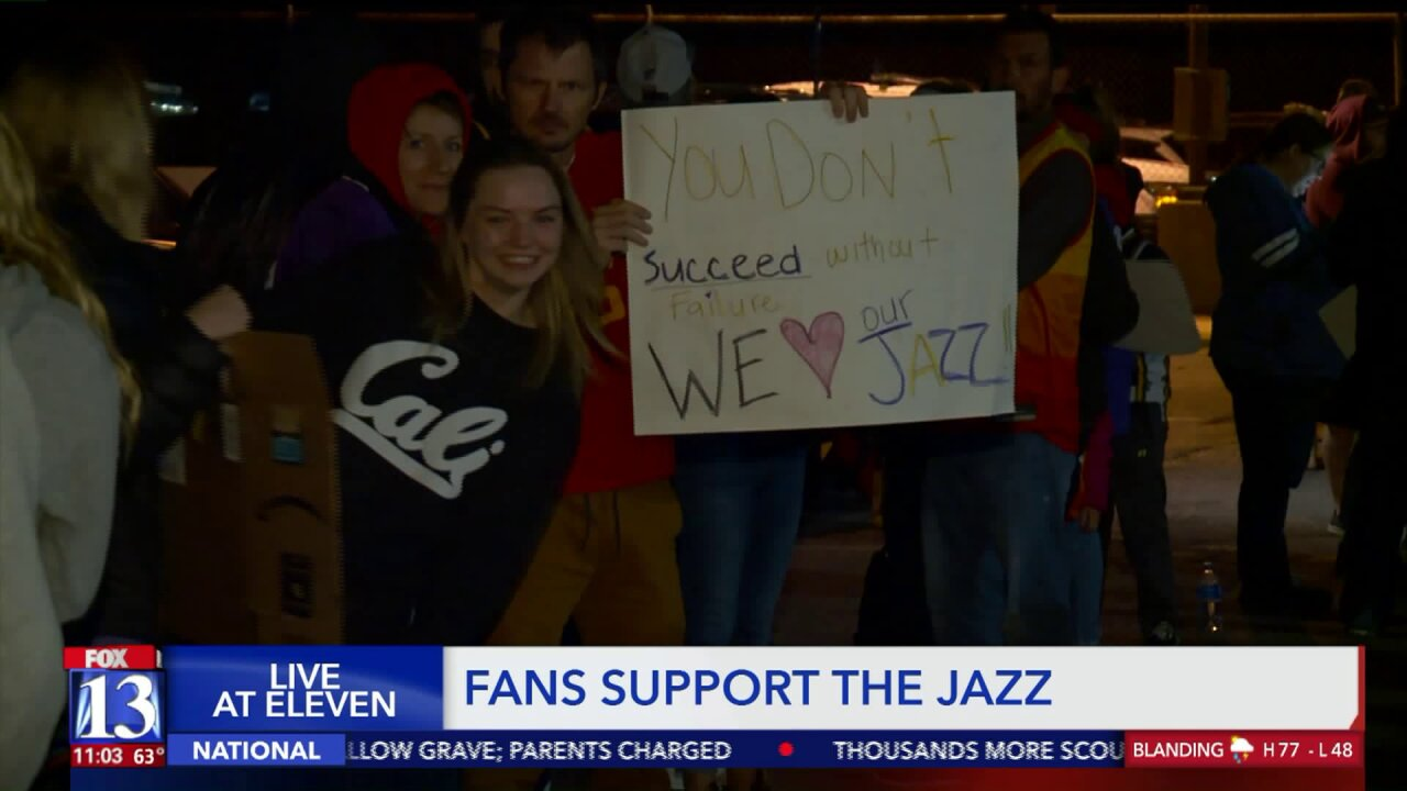 Jazz fans welcome team home at airport after season ends inHouston
