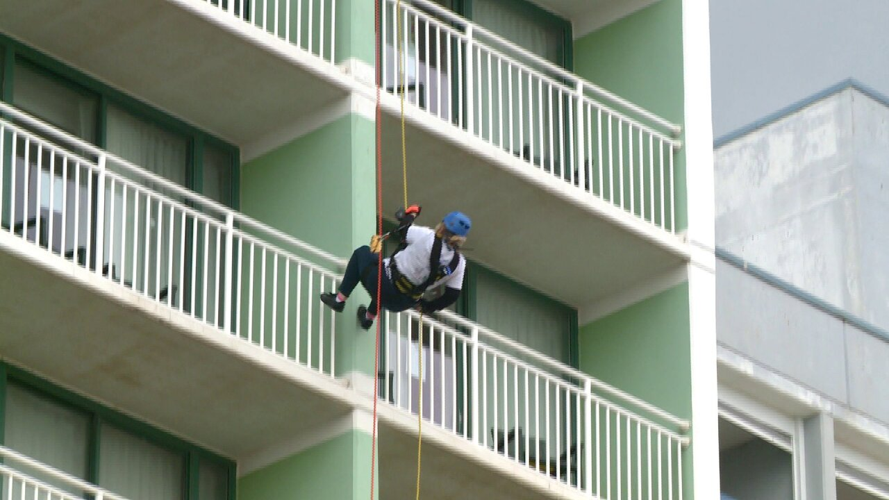 People rappel down Oceanfront hotel for charity