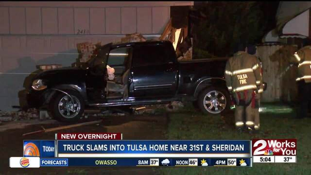 Truck slams into Tulsa home