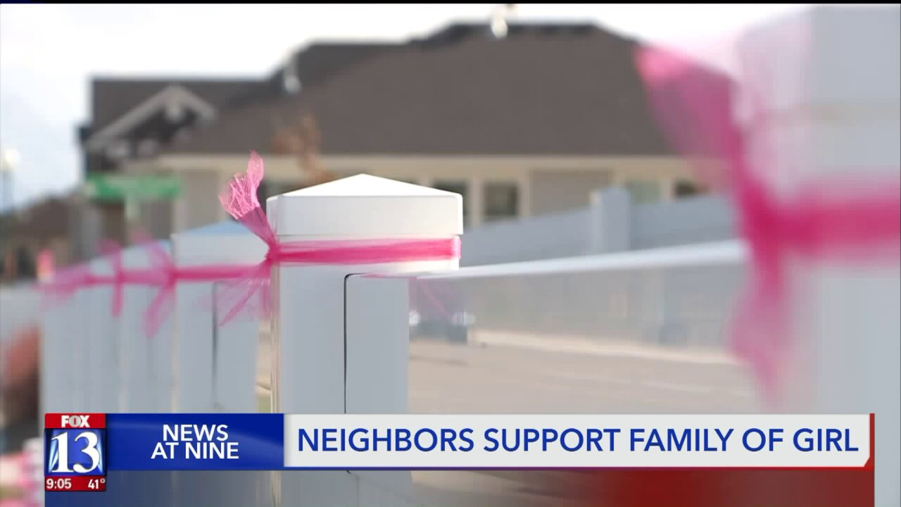 'She's still with them' – neighbors tie pink ribbons in memory of 6-year-old killed by car