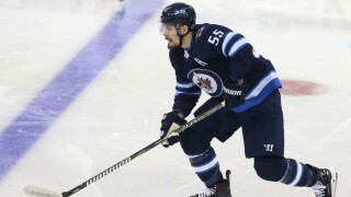 Mark Scheifele of the Winnipeg Jets moves the puck