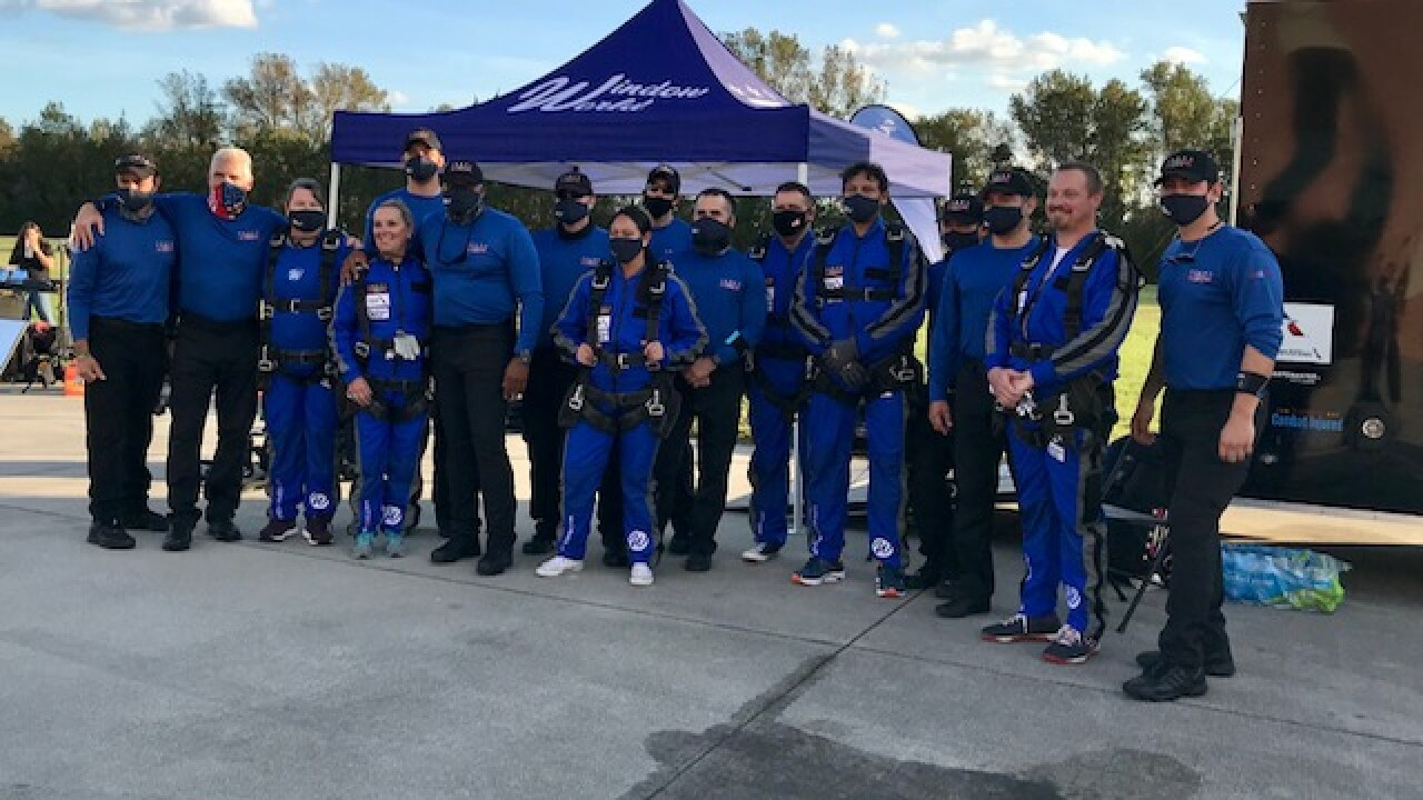 Local front line workers honored in a big way: skydiving