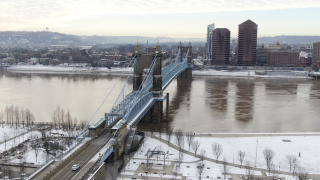 Sky 9 overlooks the John A. Roebling Bridge connecting downtown Cincinnati and Covington's Licking Riverside District, photographed Jan. 29, 2021.