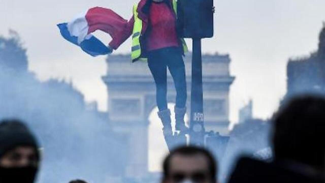 Police fire tear gas, water cannon at Paris fuel protesters