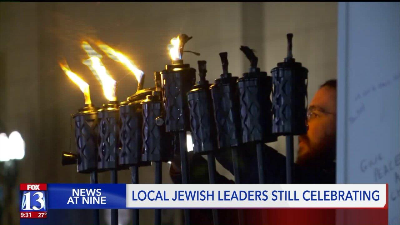 Police line sidewalk as Salt Lake Jewish community celebrates final night ofHanukkah