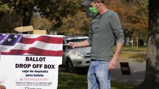Colorado Denver voting ballot box drop absentee mail vote