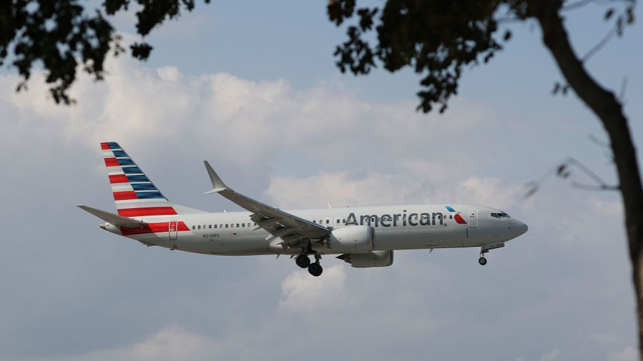Woman removed from flight for wearing 'offensive' mask