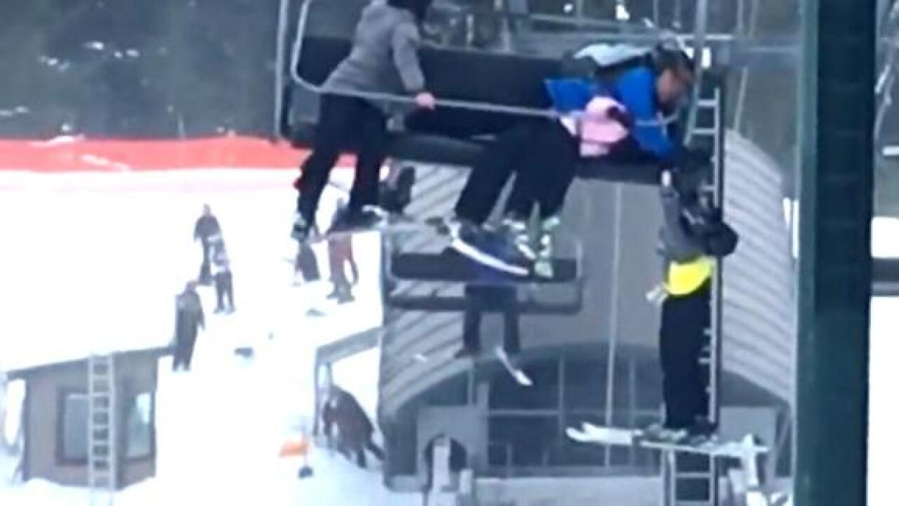 A group of teens and good Samaritans rescued a boy dangling from a ski lift