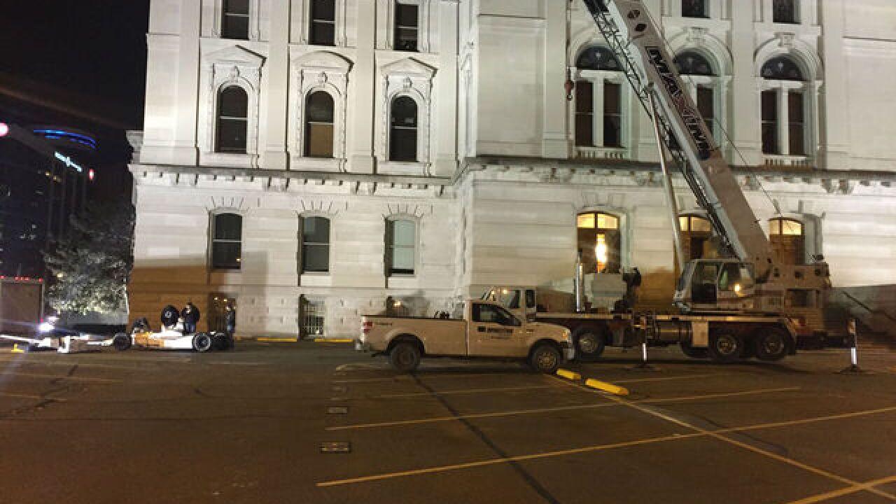 PHOTOS: Crews put IndyCar inside Statehouse