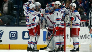 COLUMBUS, OH - DECEMBER 5: Alexandar Georgiev #40 of the New York Rangers is congratulated by his teammates after defeating the Columbus Blue Jackets 3-2 on December 5, 2019 at Nationwide Arena in Columbus, Ohio. (Photo by Kirk Irwin/Getty Images)