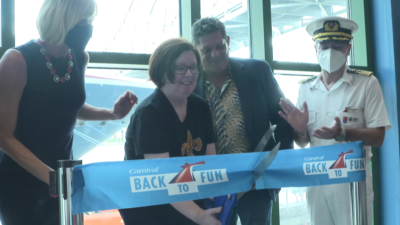 Elizabeth LaGrange of Lafayette cuts the ribbon to celebrate the return of the Carnival Glory to the Port of New Orleans today
