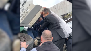 New York governor seen pulling motorist out of wrecked vehicle