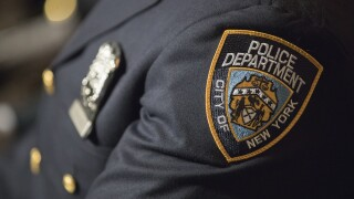 Department of Justice says NYPD cop was acting as an illegal agent for Chinese government