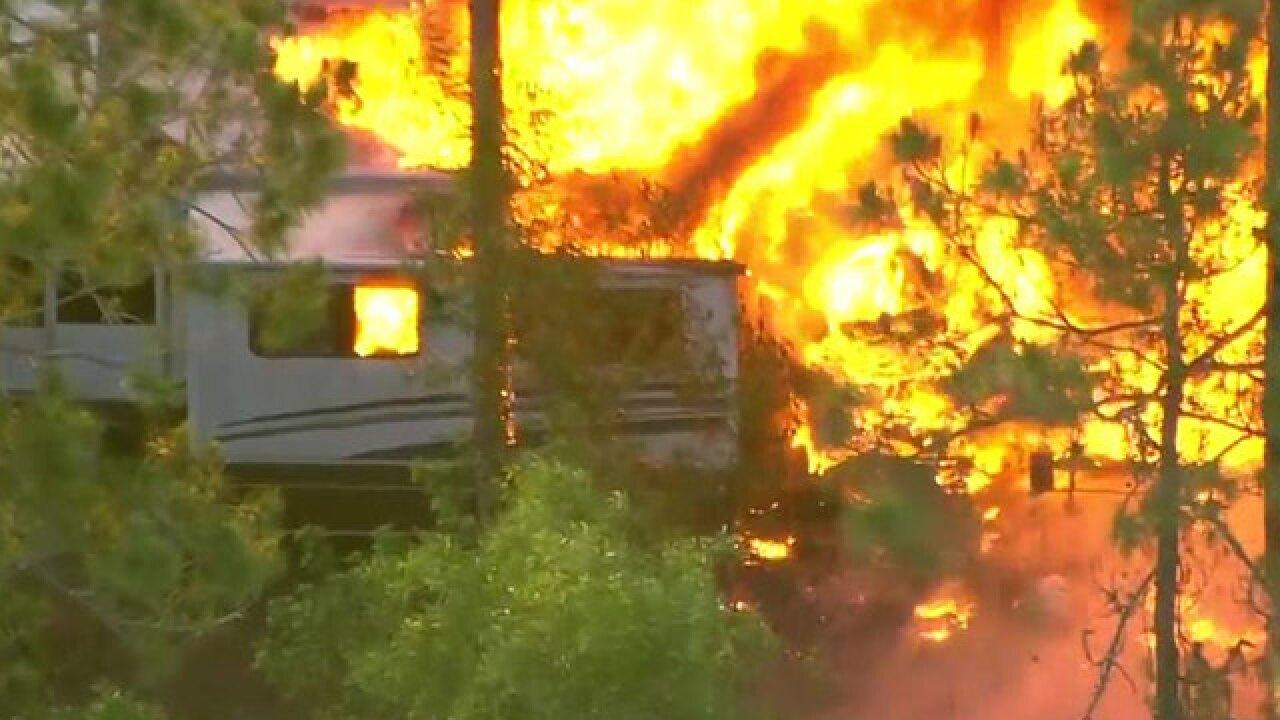 RV, brush catch fire in Loxahatchee area