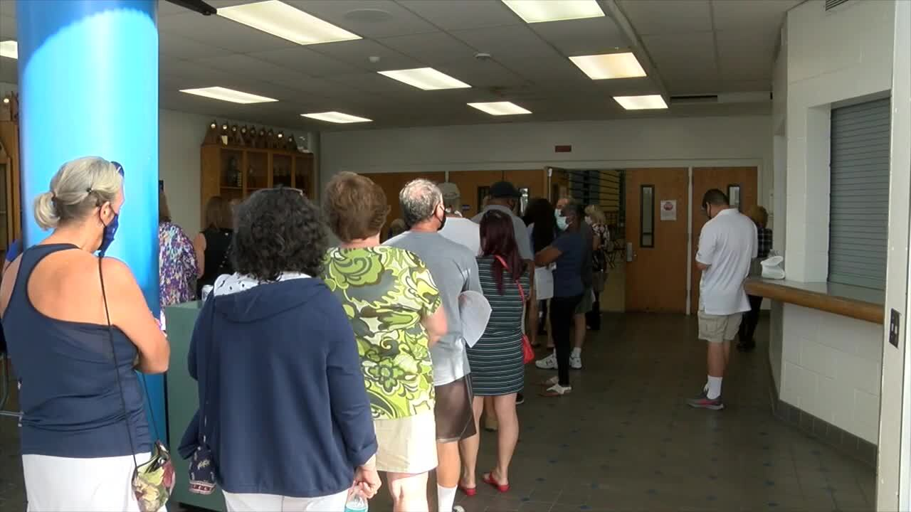 Palm Beach County school employees wait to get COVID-19 vaccine at Jaega Middle School