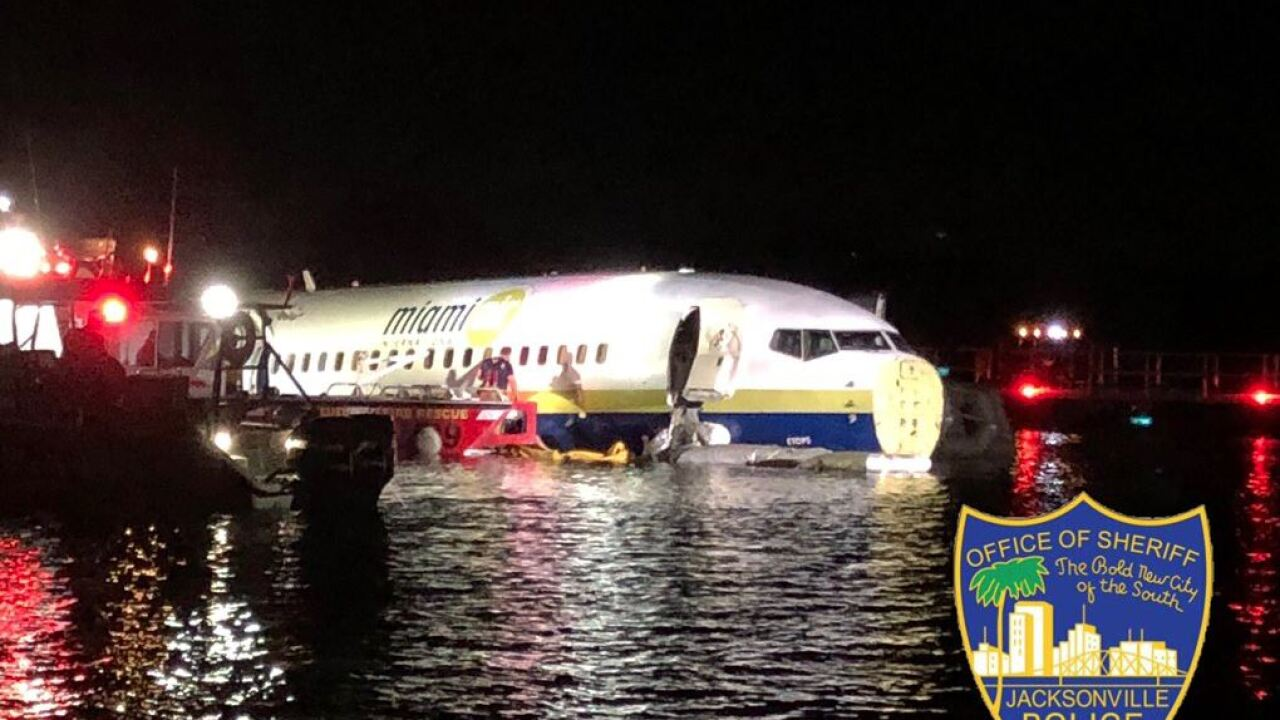 Boeing 737 coming from Guantanamo Bay slid off runway and fell into Florida river, officials say
