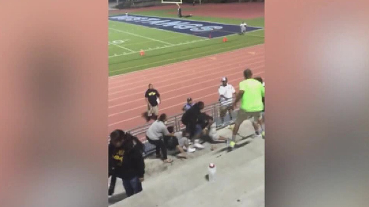 Football team kicked out of league holds protest