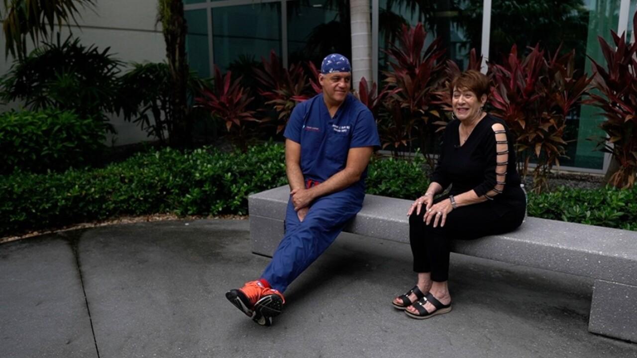 Diane Maranto and Dr. Joseph Ricotta sit outside Delray Medical Center on June 23, 2021.jpg