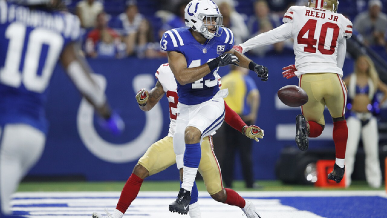 Luck's sharper touch helps lead Colts past 49ers 23-17