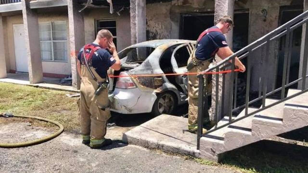 VIDEO: Car packed with propane tanks smashes into Fort Pierce apartments