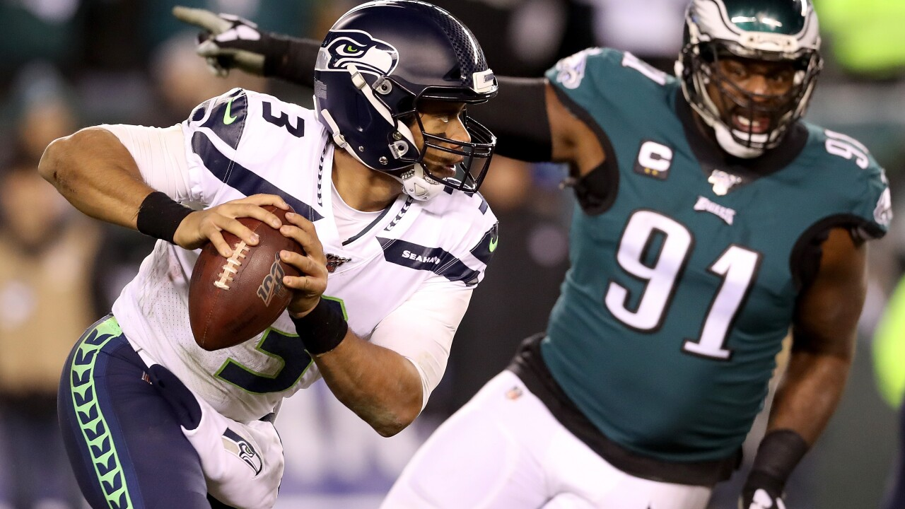 Carson Wentz leaves with head injury as Seahawks sink Eagles in NFC playoffs