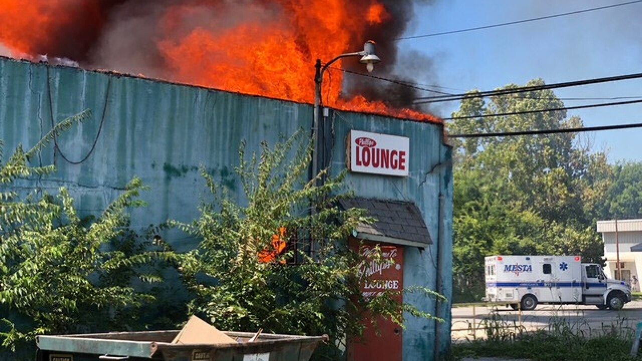 Multiple departments battle Locust Grove building fire
