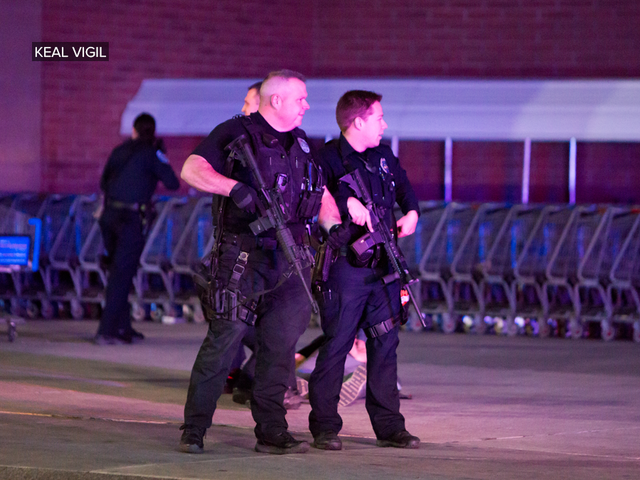 Photos capture chaotic scene after Thornton Walmart shooting