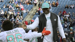 Miami Dolphins head coach Brian Flores slaps hands with wide receiver Mack Hollins, December 2019