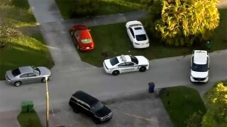 A police officer was forced to open fire after responding to a call in Hallandale Beach early Monday morning, officials said.