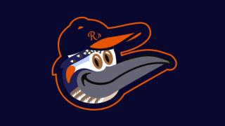 Graphic designer making art with Orioles logo