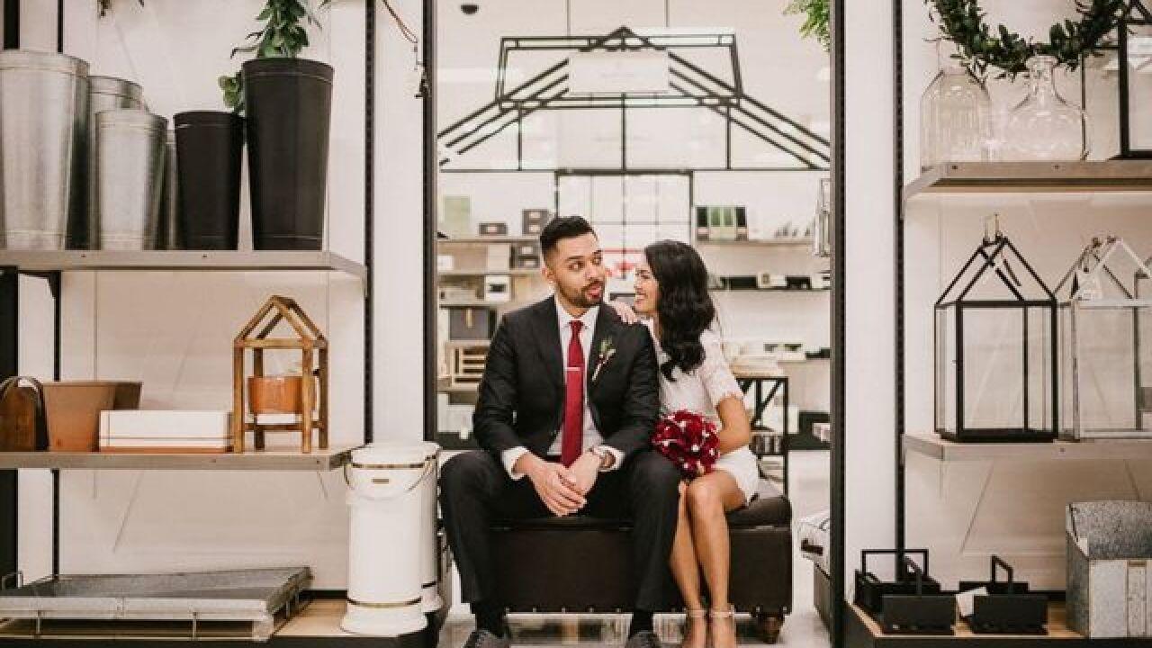 Newlyweds take wedding photos inside Target