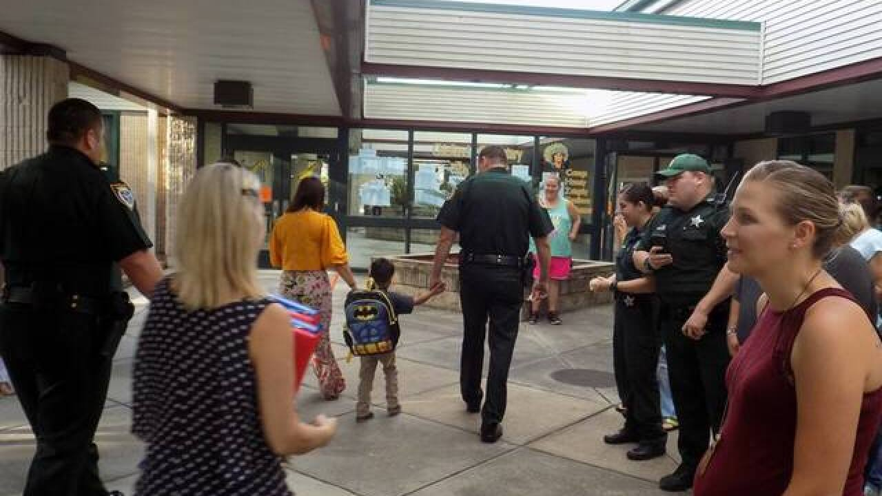 Deputies escort son of fallen officer to school