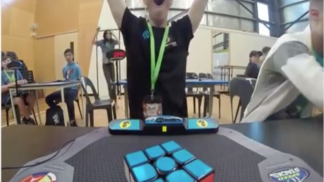 Watch this young man solve Rubik's Cube in less than 5 seconds