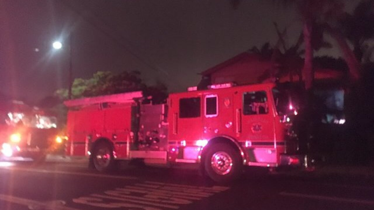 Two arrested at hazmat house fire
