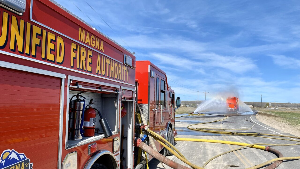 Unified Fire crews douse a fire on a garbage truck