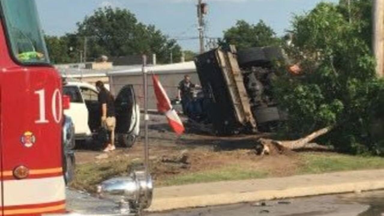 Crews cleaning up spilled diesel oil from crash