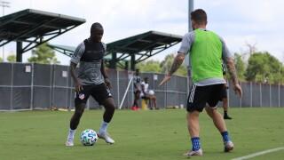 CIN midfielder Kekuta Manneh (L) CIN defender Greg Garza (R).JPG