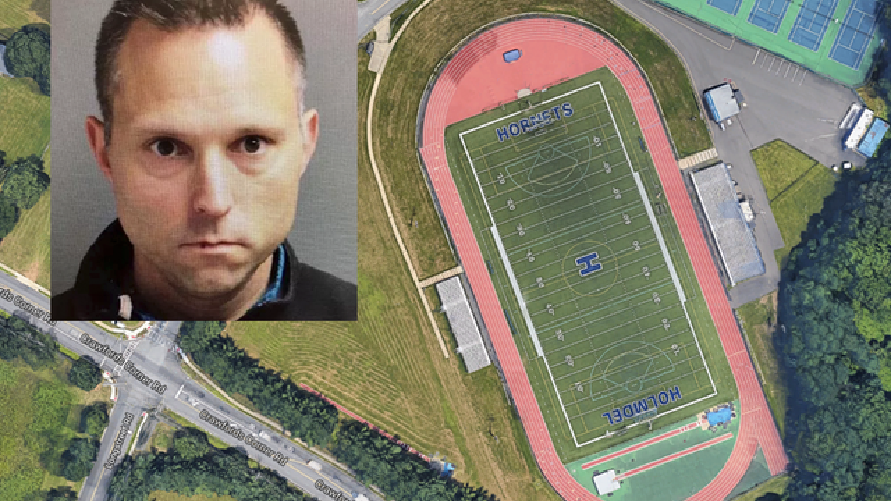 School's chief accused of pooping on track