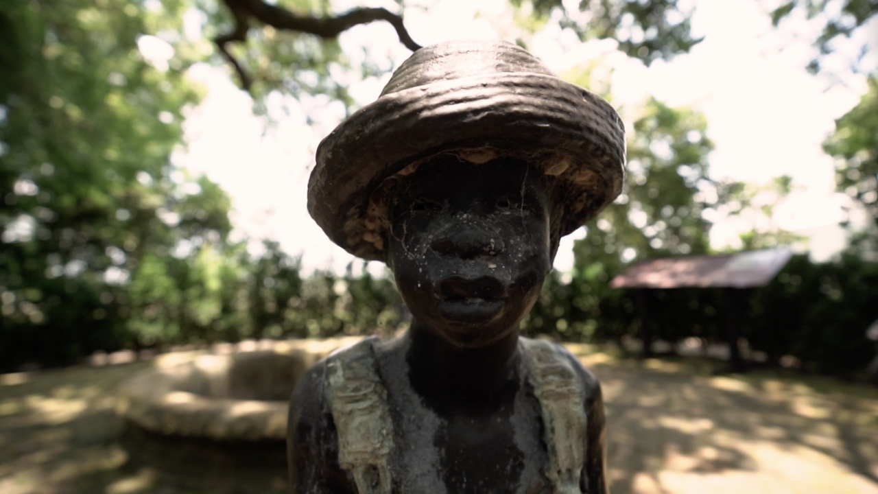 Throughout the plantation property, visitors are greeted by life-like statues known as the 'Children of Whitney.'