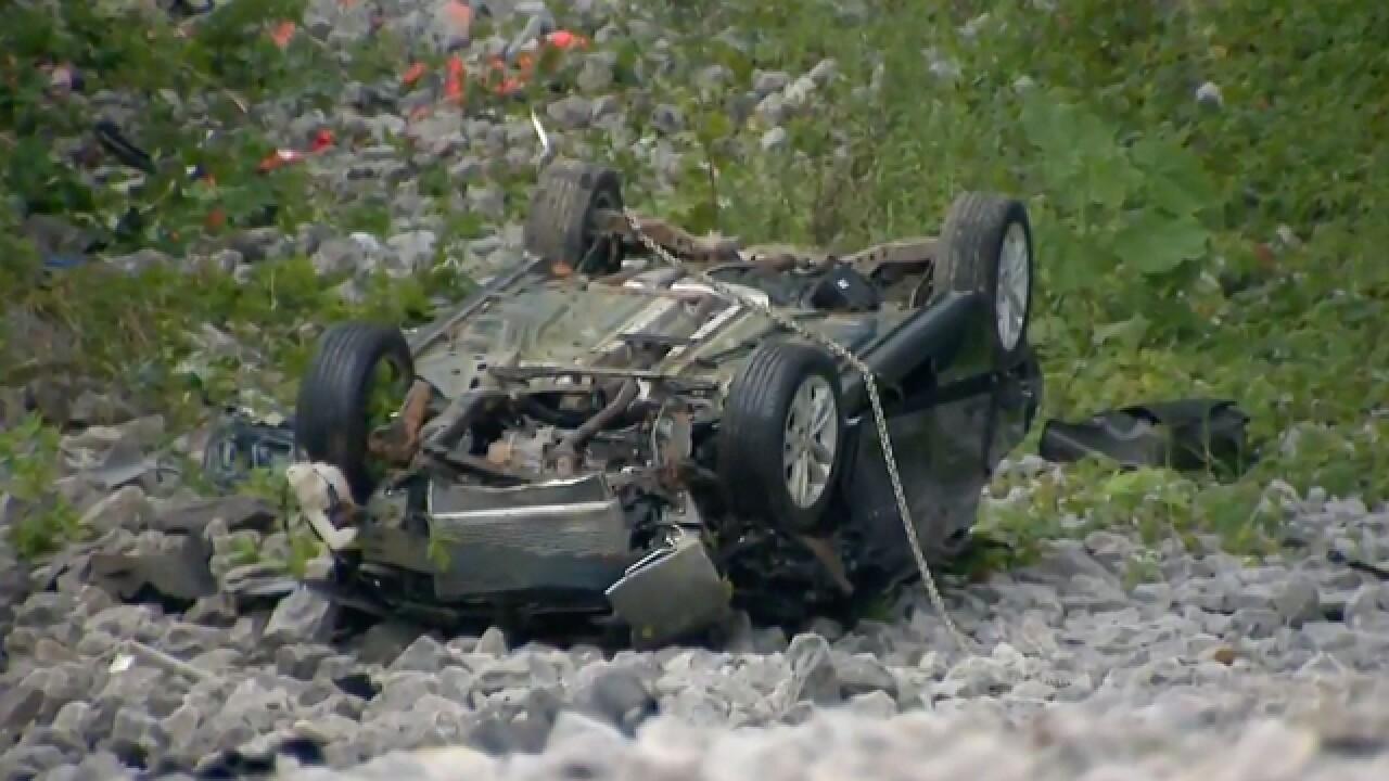 Car Travels Down Embankment, Crashes Near I-840