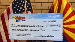 Glendale couple claims $410 million Mega Millions jackpot