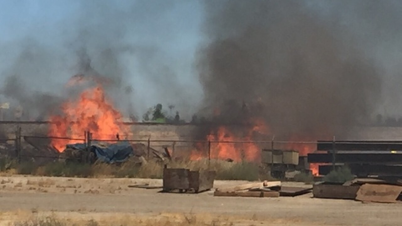 Grass fire burning along Highway 99 and Golden State Avenue