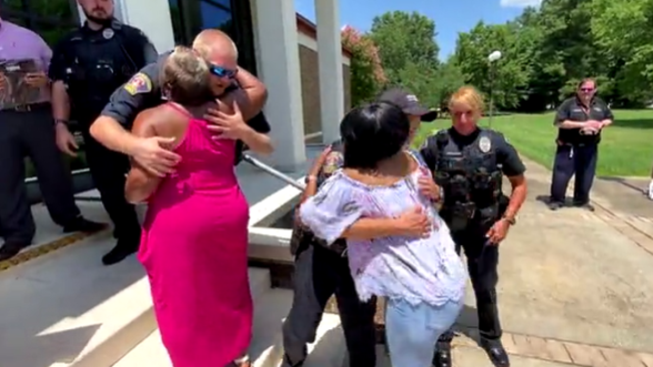 Prince George officers who rescued man from burning car honored by family