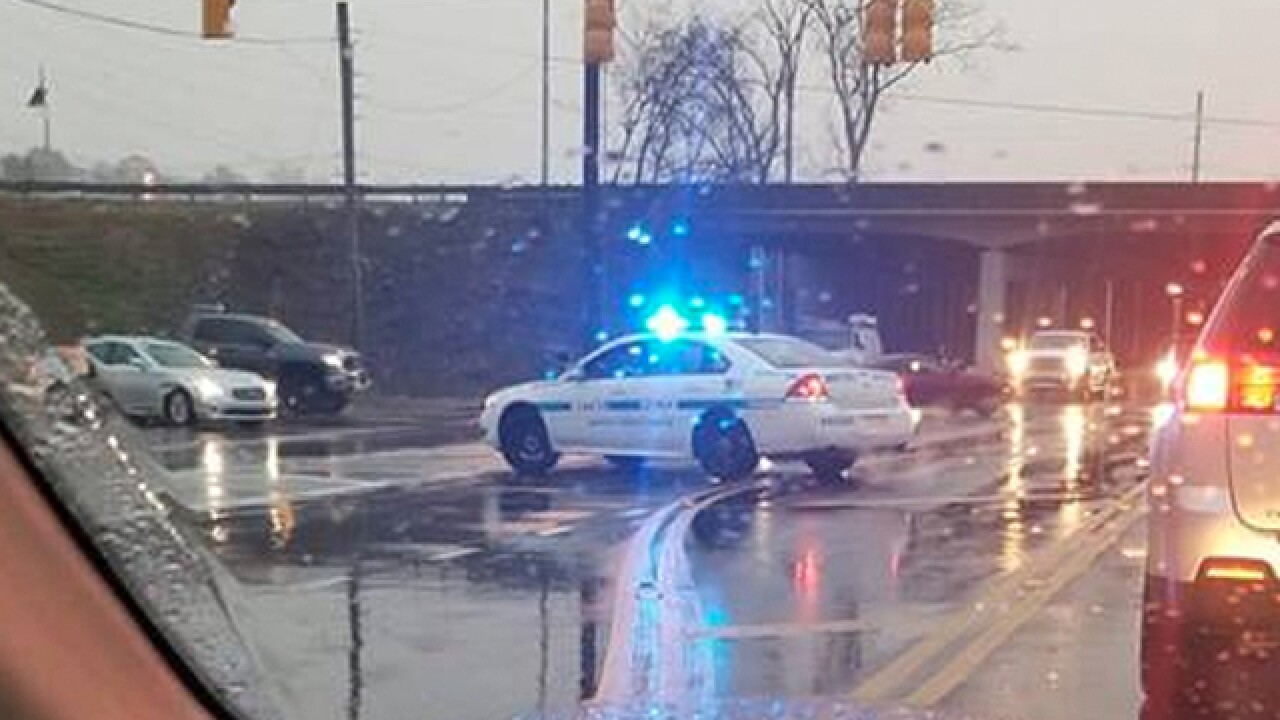 Metro Nashville police officer gives meal to homeless man standing in the rain
