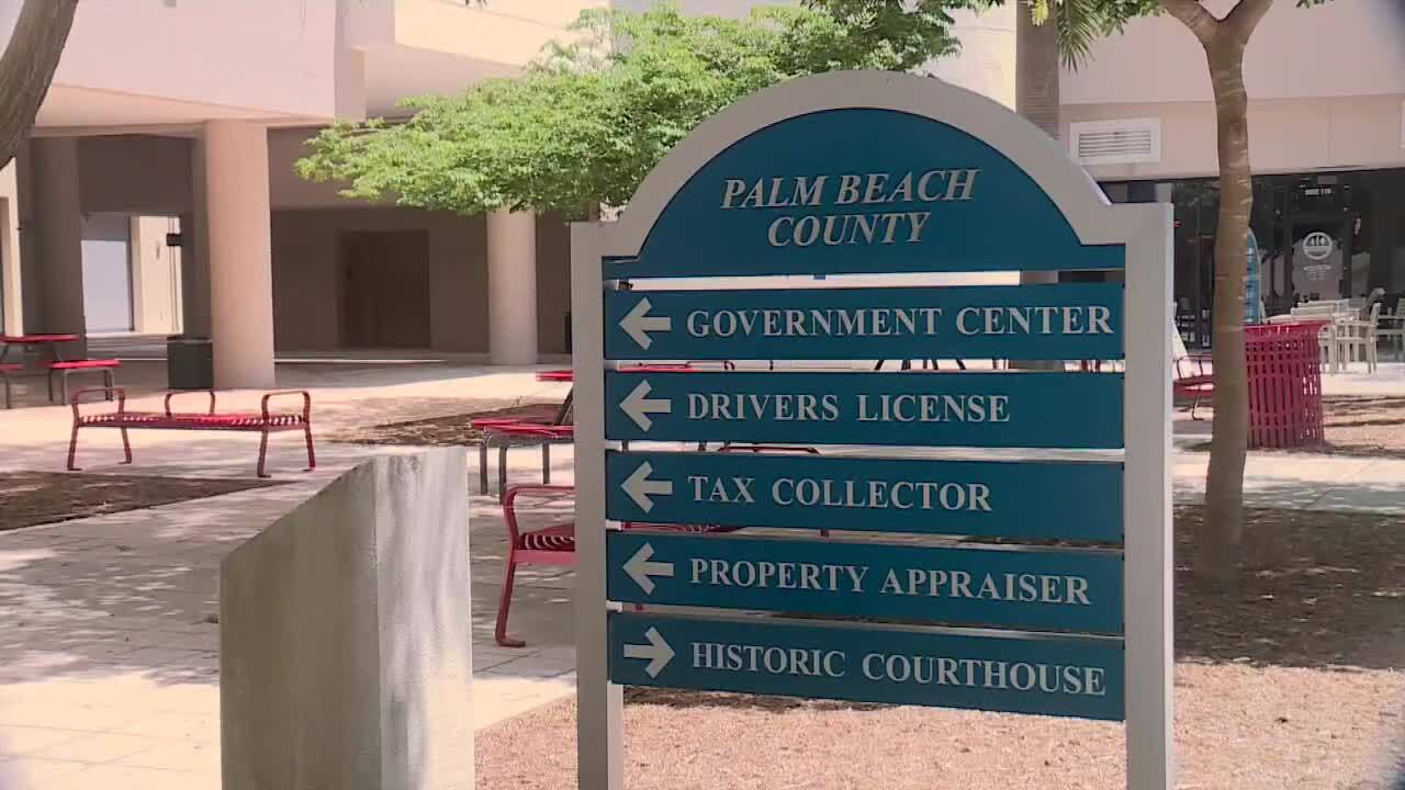 sign with arrows pointing in direction of Palm Beach County government buildings in downtown West Palm Beach