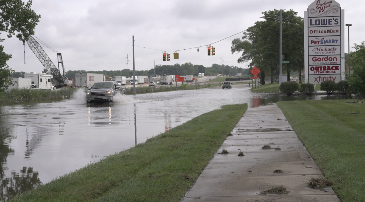 Truck attempting to drive through flood waters in Jackson