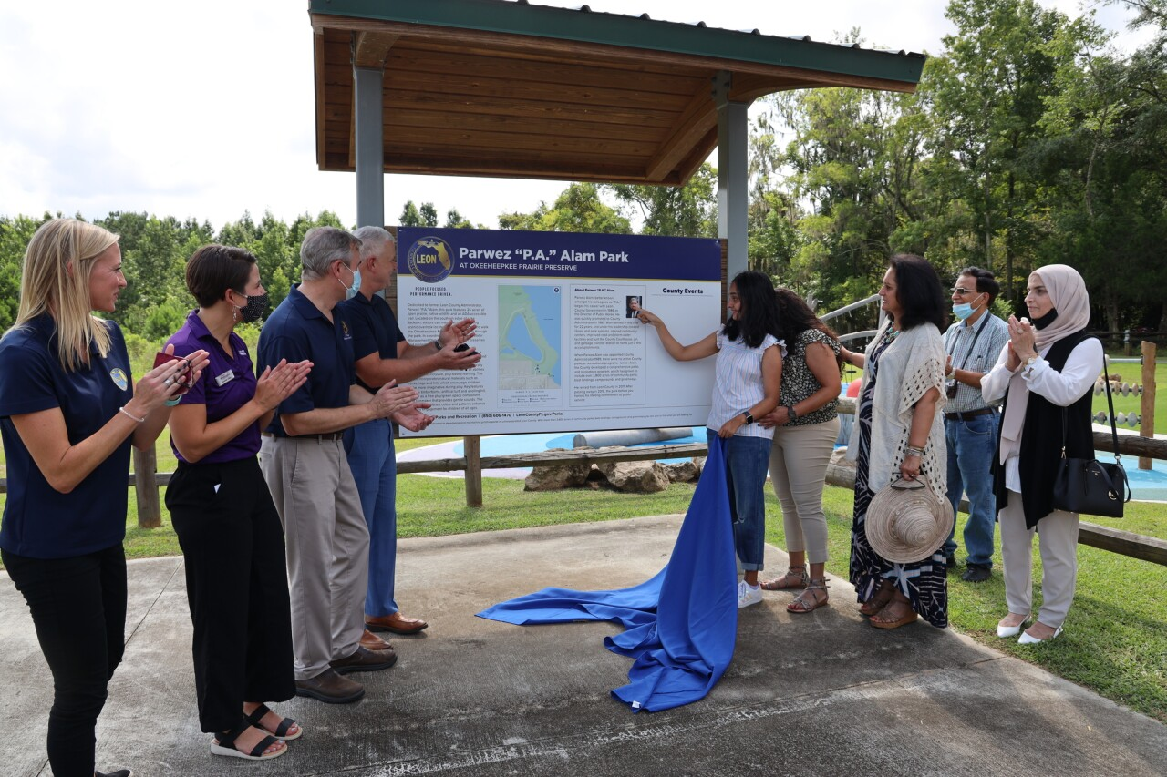 """Parwez """"P.A."""" Alam park dedication at Okeeheepkee Prairie Preserve. PC: Leon County  Pictured (left to right): Amanda Heidecker, Leon County Parks and Recreation Director; Amanda Lewis, Owner of Future Pathways; Rick Minor, Leon County Commission Chairman and District 3 Commissioner; Vince Long, Leon County Administrator; Zahra Alam, P.A.'s daughter; Adeena Alam, P.A.'s daughter; Ghazala Alam, P.A.'s sister"""